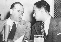 Senator Joseph McCarthy chats with his attorney,...