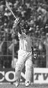 Indian batsman Sachin Tendulkar raises his bat to...