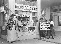 Women at a women's suffrage booth in New York...