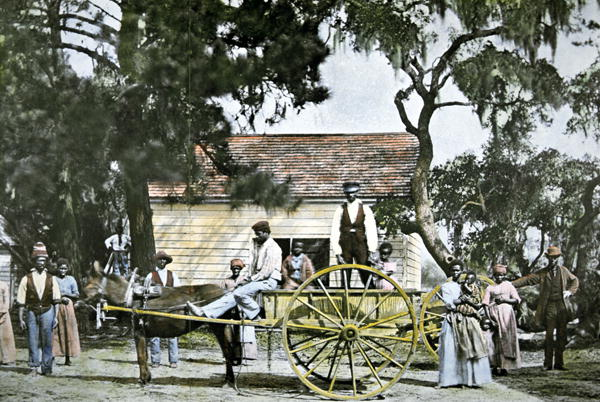 faded color photo of field workers on the Hopkinson plantation in 19th century South Carolina