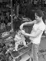 Mother and toddler in market in...