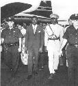 Prime Minister Patrice Lumumba (second from left)...