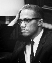 Malcolm X (1925-1965) during a press conference...