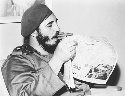 Cuban leader Fidel Castro in 1961, reading a...
