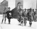 U.S. marines in 1932 hold the flag of Augusto...