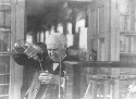 Thomas Edison experimenting in his laboratory....