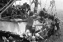 Crewmen on a commercial salvage expedition lift a...