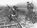 British marines plant explosives along a railroad...