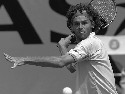 Guga Kuerten plays in a match against Agustin...