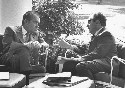 President Richard Nixon in deep discussion with...