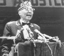 Elijah Muhammad addresses followers, including...