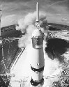 The Saturn V rocket lifts off on the way to the...