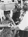 In this 1969 photo a Nigerian girl winces as she...