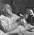 Henri Matisse working on paper cutout....