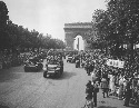 Crowds of French patriots line the Champs Elysées...