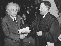 Albert Einstein receives from Judge Phillip...