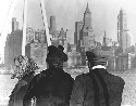 An immigrant family looks out over the New York...