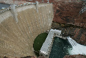 Water is released from Glen Canyon Dam near Page,...