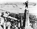King Kong stands atop New York's Empire State...