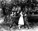 The Scarecrow, played by Ray Bolger, and Dorothy,...