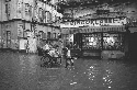 English-language bookstore on a flooded street....