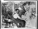 Mexican painter Diego Rivera seated in front of...