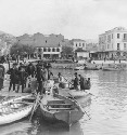 Greek immigrants embarking in a small boat bound...