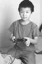 A Chinese boy playing a video game....