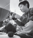 Fifth graders knit during class at Waldorf School...
