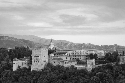 The Alhambra, located in Granada, Spain, stands...