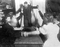 Medium holds a séance, ca. 1920. In the early...