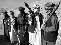Members of the Taliban pose with AK-47 assault...