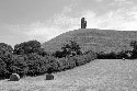 Glastonbury Tor is a conical hill rising from the...