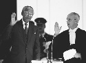 President Nelson Mandela at his inauguration as...
