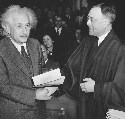 Albert Einstein receiving from Judge Phillip...