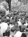 A crowd listens to Allen Ginsberg give a reading...