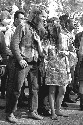 A young hippie couple enjoy a festival in San...