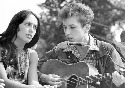 Folk singers Joan Baez and Bob Dylan entertain...
