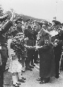 Adolf Hitler receiving flowers on behalf of...