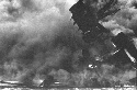 The USS Arizona on fire in Pearl Harbor as the...