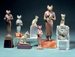 Several statuettes of the cat-goddess Bast and cat figurines representing the same goddess, Egyptian, Late Period, c.664-300 BC (bronze)