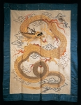 Wall hanging embroidered with a writhing gilt dragon among clouds, late 19th century (silk)