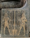 Granite sculptural group with Horemheb making offerings to god Atum, detail of throne of Atum with Seth and Horus