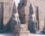 Temple of Luxor, pylon of Ramses II, two colossal statues of the king