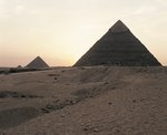 Egypt, Cairo, Ancient Memphis, Pyramids at Giza. Pyramid of Khafre (greek: Chephren) and Pyramid of Menkaure (greek: Mykerinus) in the background, sunset