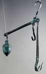 Steelyard balance with bronze hook for hanging goods to weigh and acorn counterweight decorated with stripes at top, artifact uncovered in Pompeii, Campania, Italy, Roman Civilization, 1st century