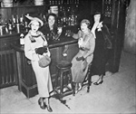 New York society women enjoy their first legal drink after the repeal of the Volstead Act in 1933 (b/w photo)