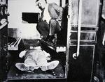 John Dillinger dead in a police wagon, 22nd July 1934 (b/w photo)
