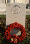 Headstone of an Australian soldier with poppy wreath, at the British WW1 Mass Cemetery at Tyne Cot, Flanders (photo)