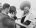 Mae West on her first visit to England, arriving...